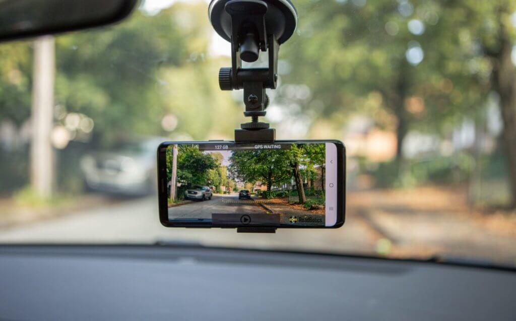 RoadBotics' smartphone in windshield of car